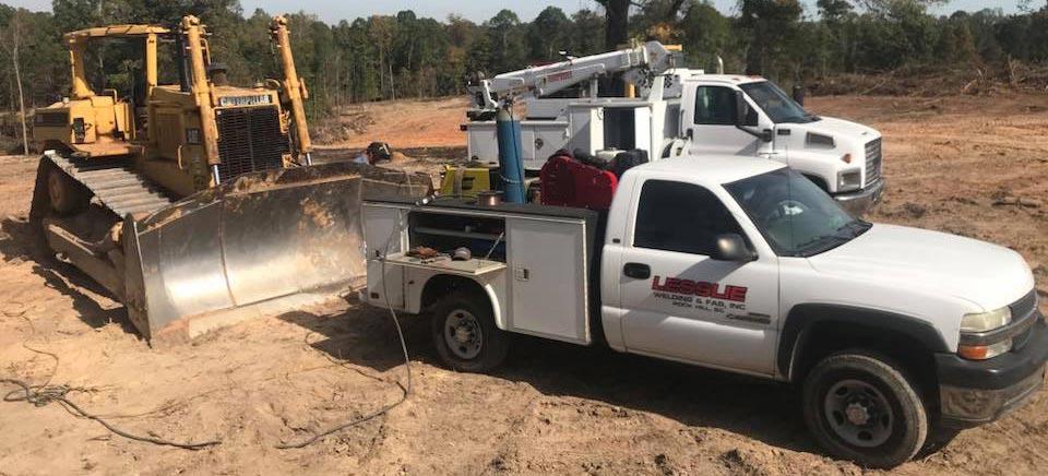 Lesslie Welding & Fabrication | Rock Hill, SC | trucks on job site