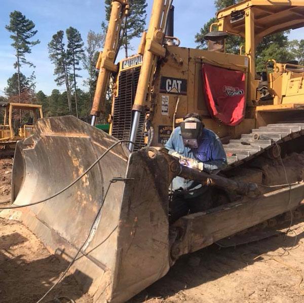 Lesslie Welding & Fabrication | Rock Hill, SC | welding on a construction vehicle